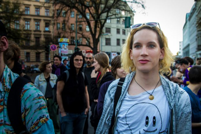 Trans Woman Claims Civil Rights Violation After Man Avoids Eye Contact - Trans Woman at protest